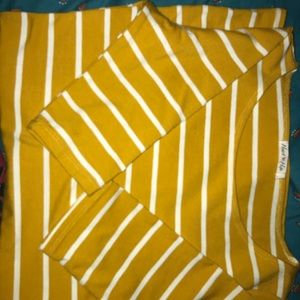 yellow and white stripped dress .